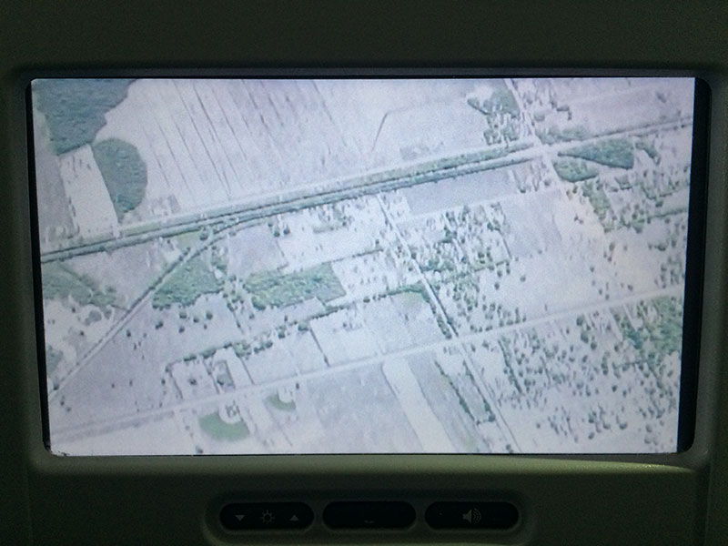 We are observing the country from the airplane.